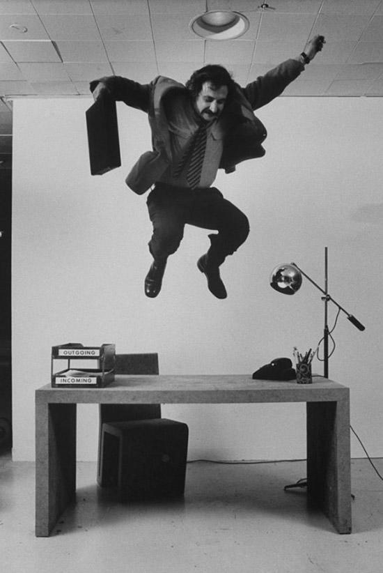Frank-Gehry-jumping-on-his-cardboard-furniture