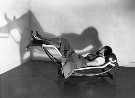 Charlote-Perriand-lying-on-lounge-chair